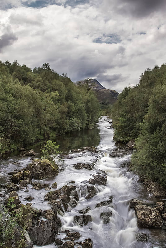 Floating water in the scottish highlands by Leander Nardin for Stocksy United