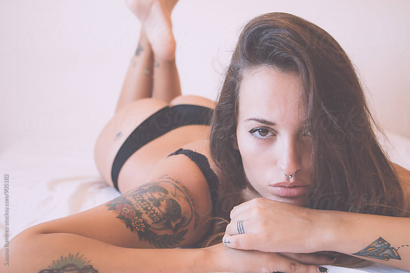 Portrait of sexy woman on bed by Susana Ramírez for Stocksy United