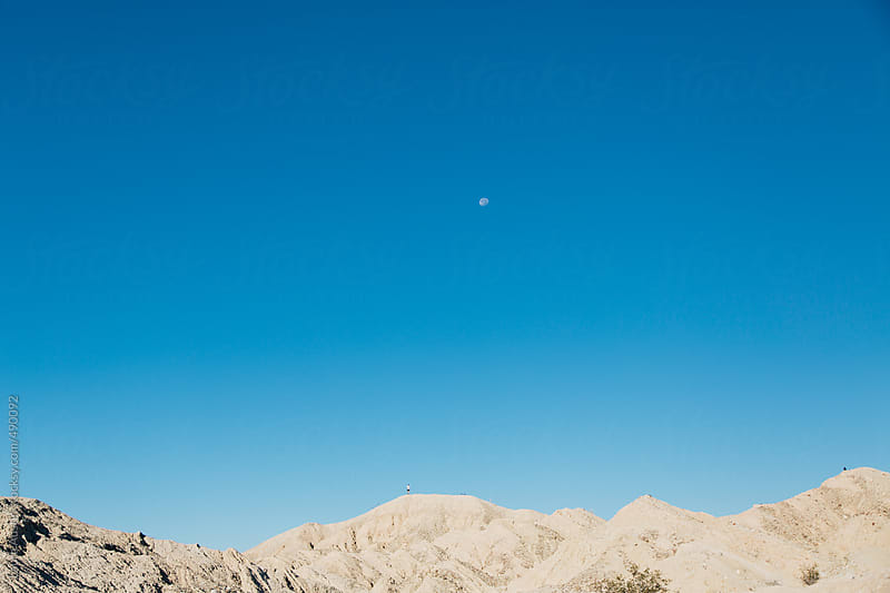 Small Person Standing On A Mountain In The Desert by Laura Austin for Stocksy United