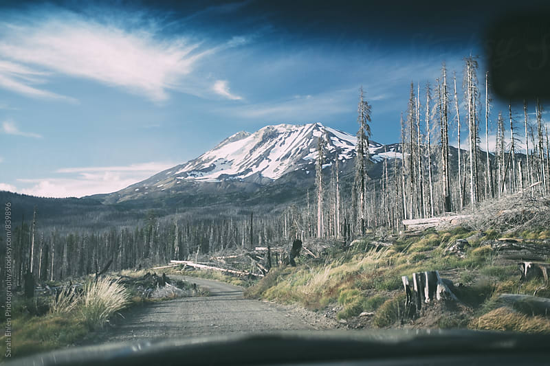 A mountain is seen through the windshield by Sarah Ehlen Photography for Stocksy United