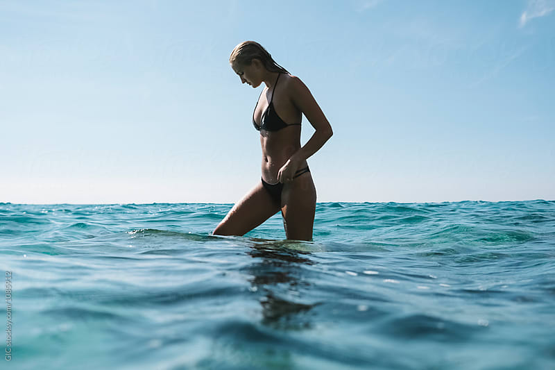 Attractive blonde woman in the sea by Simone Becchetti for Stocksy United