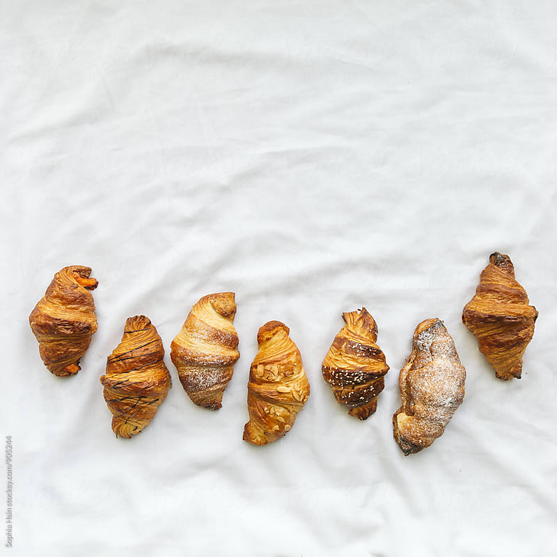 Croissants neatly organized by Sophia Hsin for Stocksy United