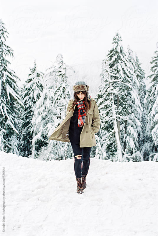 Young woman smiling in snow by Daniel Kim Photography for Stocksy United
