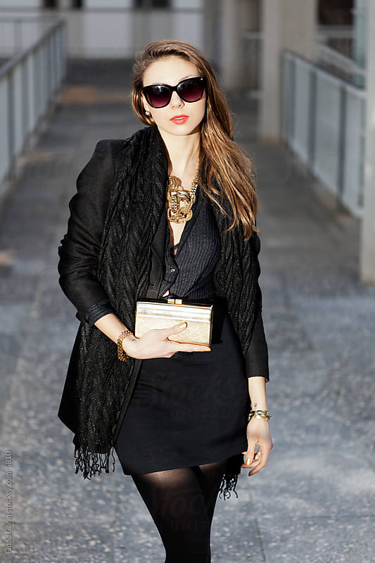 Black & Gold Winter Fashion Chic Woman by Eldad Carin for Stocksy United