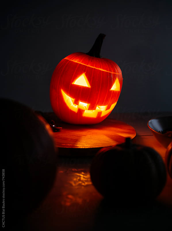 Halloween. Making a jack-o-lantern by CACTUS Blai Baules for Stocksy United