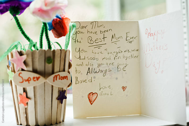 Mother's day card along side a sweet handmade gift from a young girl. by Carolyn Lagattuta for Stocksy United