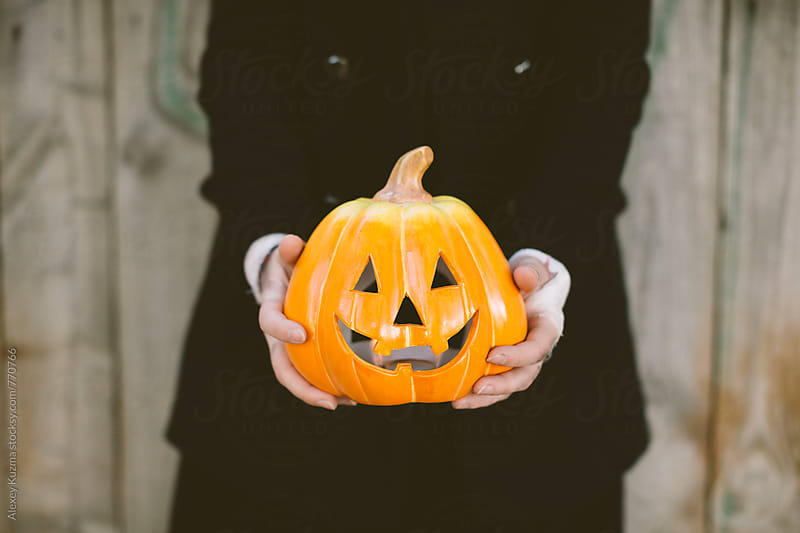 hands of young woman with pumpkin  by Alexey Kuzma for Stocksy United