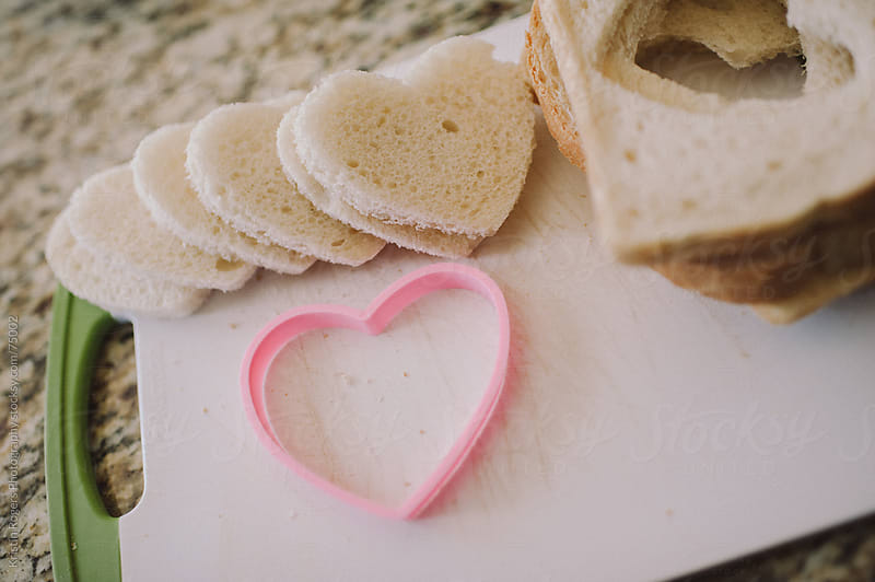 Making heart shaped french toast for breakfast by Kristin Rogers Photography for Stocksy United