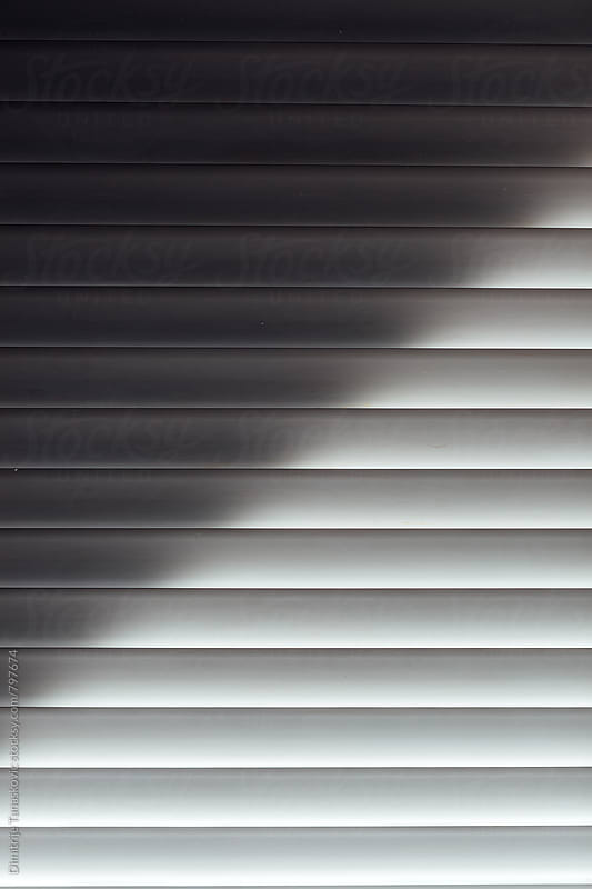 Blinds over the window by Dimitrije Tanaskovic for Stocksy United