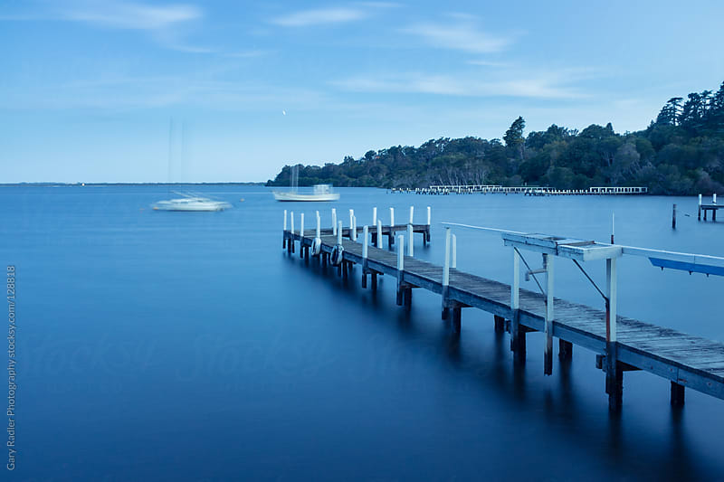 Boats moored in Mallacoota Inlet, Victoria, Australia by Gary Radler Photography for Stocksy United