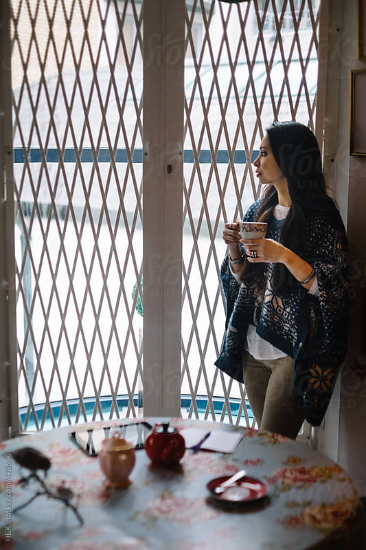 Beautiful Asiatic Woman At Home With a Cup of Tea by HEX. for Stocksy United