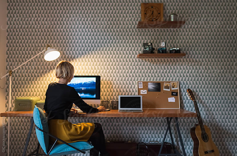 Young businesswoman working in her home office by GIC for Stocksy United