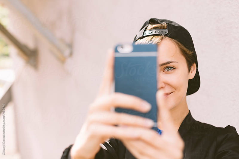 happy young woman  making a selfie by Alexey Kuzma for Stocksy United