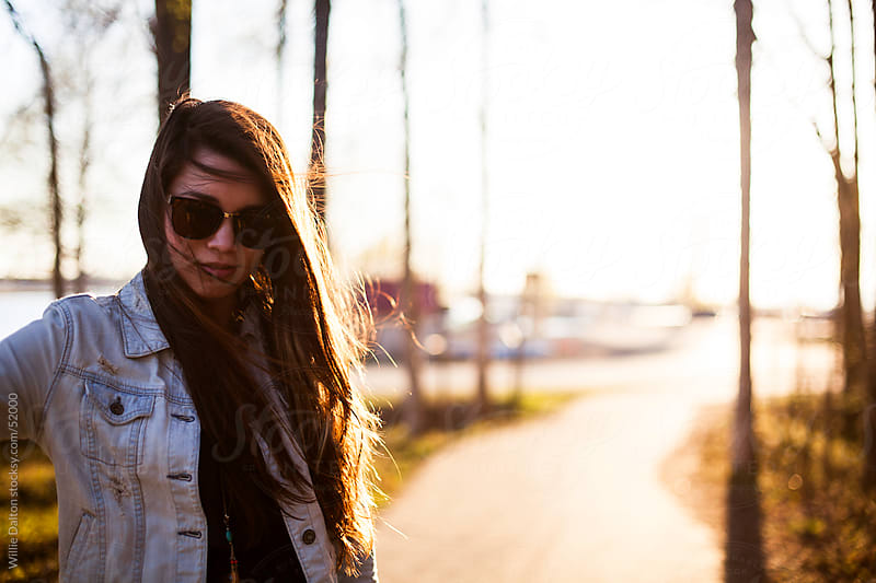 Girl in Sunglasses at Sunset with Windblown Hair by Willie Dalton for Stocksy United