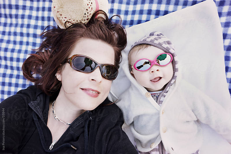 Mother and Child wearing Sunglasses for a Fun Portrait by Ina Peters for Stocksy United