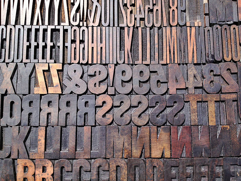 Vintage wooden printing letter blocks in various typefaces. by Greg Schmigel for Stocksy United