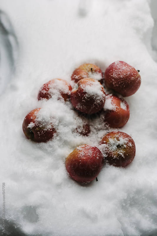 Apples in the snow by Natasa Kukic for Stocksy United