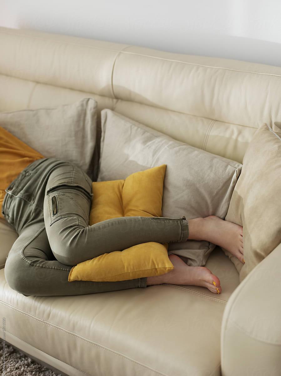 Crop barefoot woman sleeping on sofa by Milles Studio ...