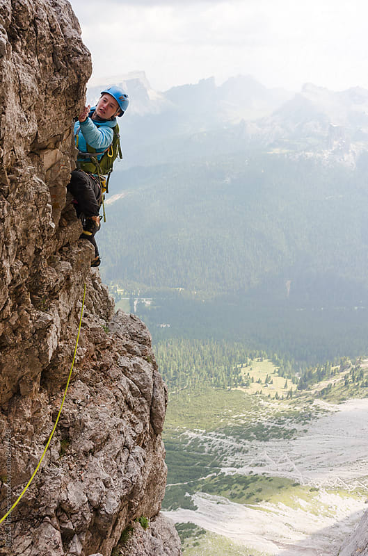 Female alpinist rock climbing in Dolomites Mountains by RG&B Images for Stocksy United