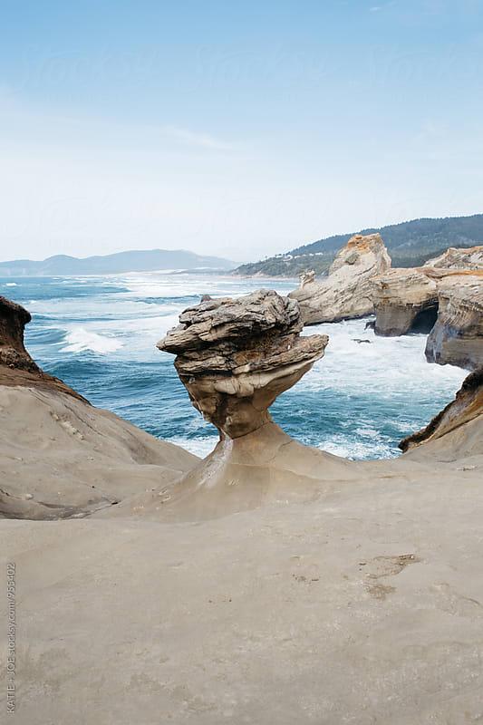 Rocky terrain and the ocean by KATIE + JOE for Stocksy United