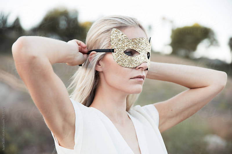 Woman wearing a mask by Ivan Solis for Stocksy United