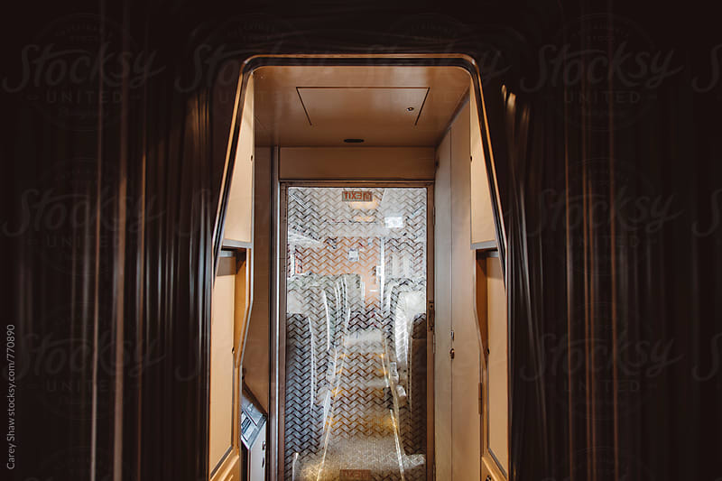 Hallway and doorway of train by Carey Shaw for Stocksy United