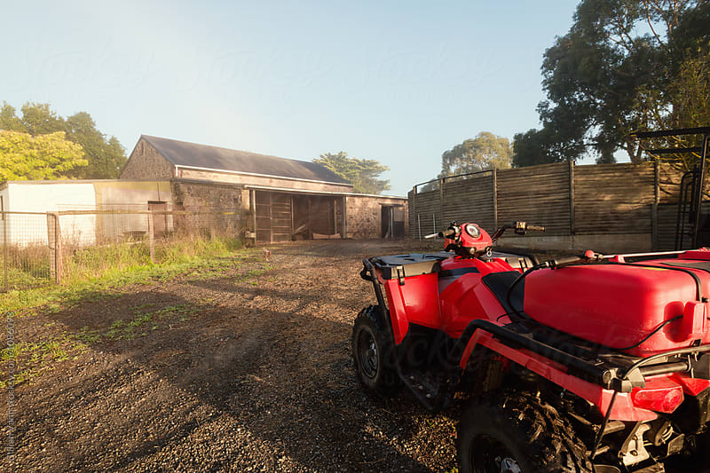 quad bike on a farm in the morning light by Gillian Vann for Stocksy United