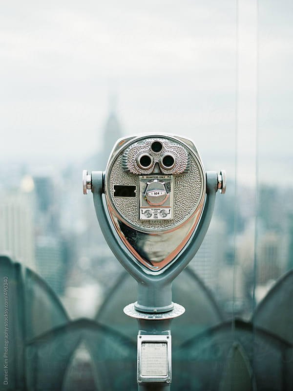 Tower binoculars overlooking city by Daniel Kim Photography for Stocksy United