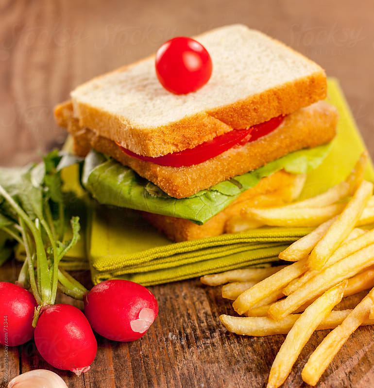 Sandwiches with french fries.  by Mosuno for Stocksy United
