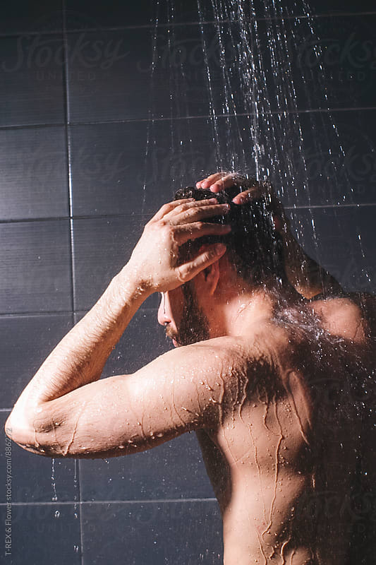 Muscular man washing hair in shower by Danil Nevsky for Stocksy United
