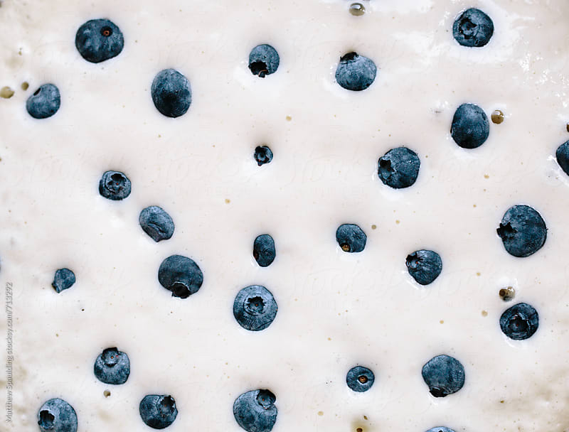 Delicious fresh blueberries in pancake cooking for breakfast by Matthew Spaulding for Stocksy United
