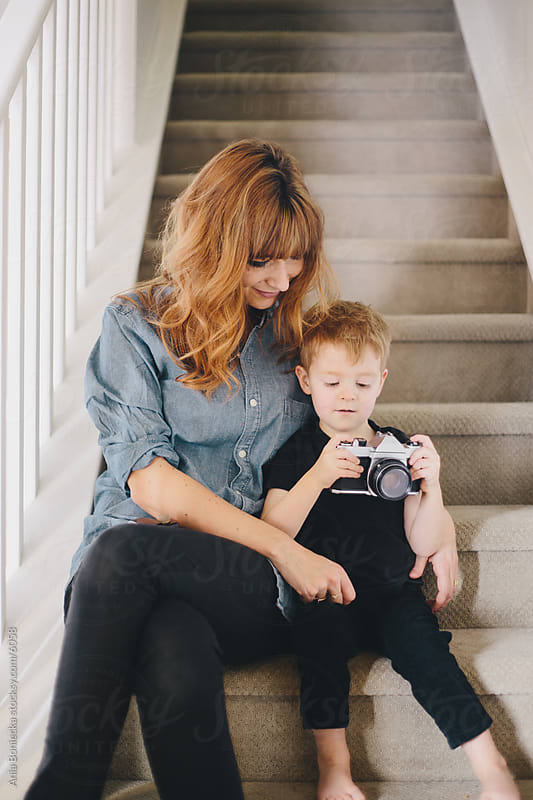 A woman and her son looking at a camera by Ania Boniecka for Stocksy United