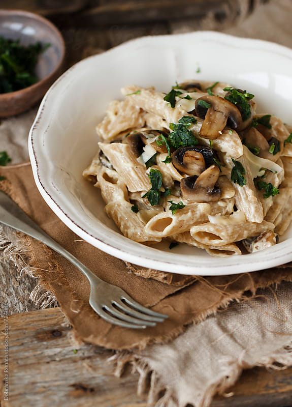 Pasta with mushrooms and cheese by Dobránska Renáta for Stocksy United