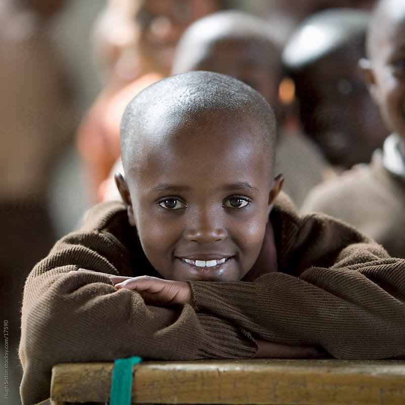 Maasai school boy in classroom.  by Hugh Sitton for Stocksy United