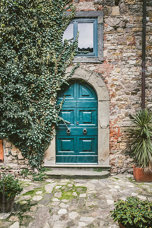 Wooden Door in Old Italian Village by Giorgio Magini for Stocksy United