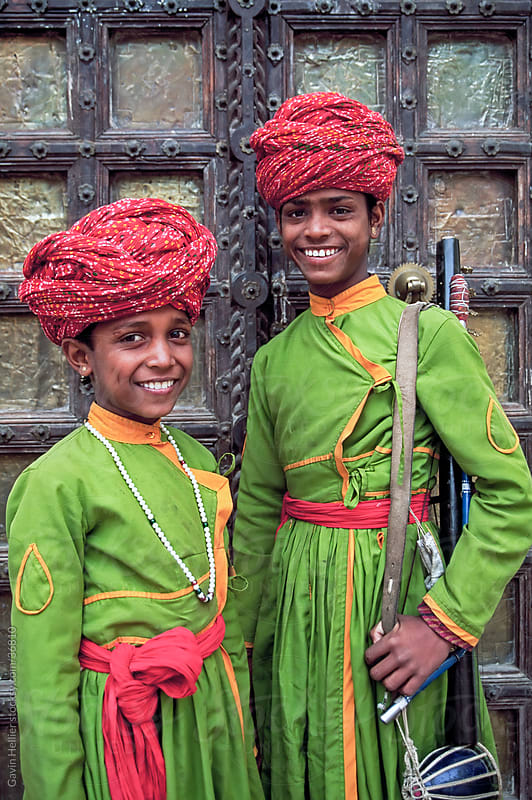 Portrait of two young boys in turbans standing in front of a wooden door, Samode Palace, Jaipur, Rajasthan state, India, Asia by Gavin Hellier for Stocksy United