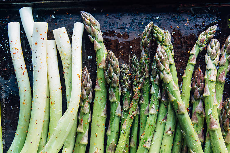 Asparagus and spring onions ready for grilling by Gabriel (Gabi) Bucataru for Stocksy United