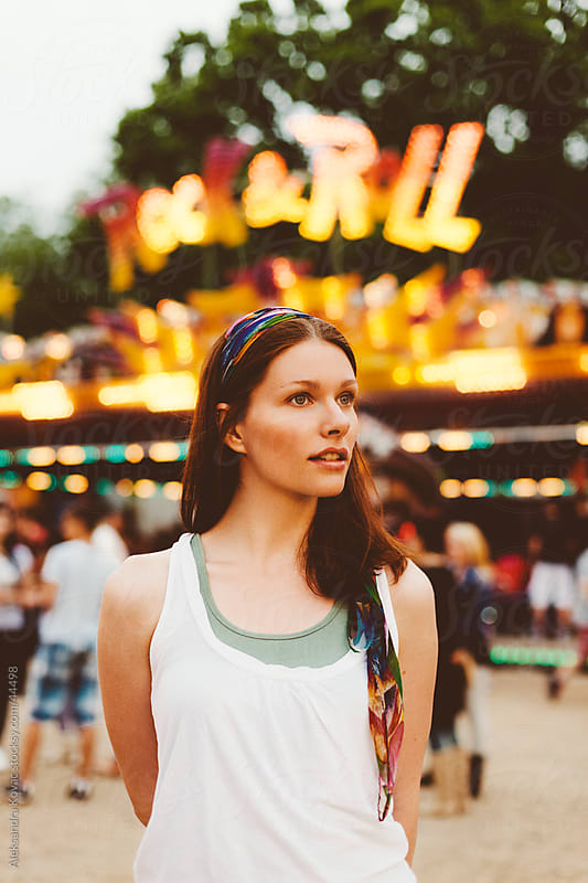 Young woman at amusement park by Aleksandra Kovac for Stocksy United