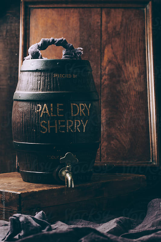 Pale dry sherry barrel in rustic wooden setting. by Darren Muir for Stocksy United