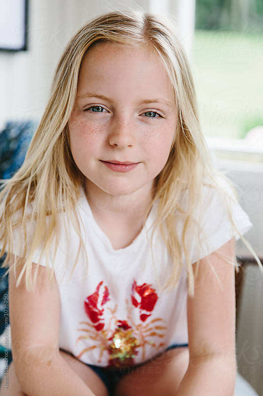 Nine year old girl by Helen Rushbrook for Stocksy United