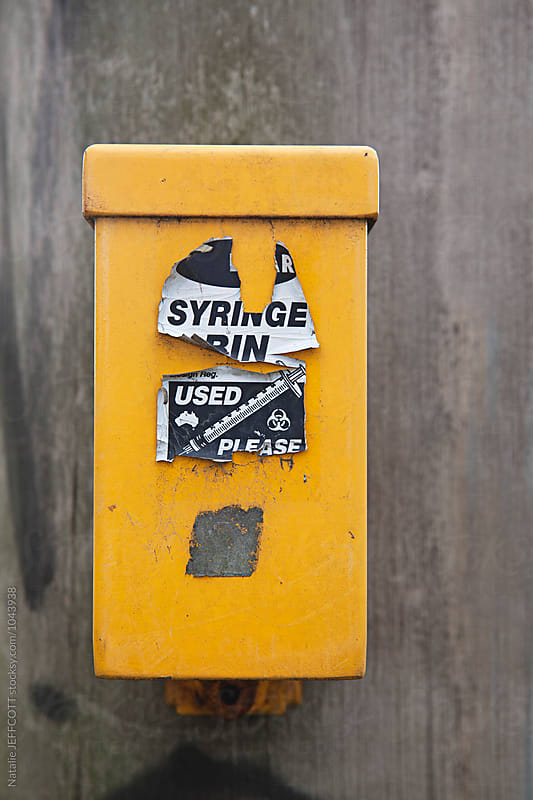 Syringe disposal box for drug use by Natalie JEFFCOTT for Stocksy United