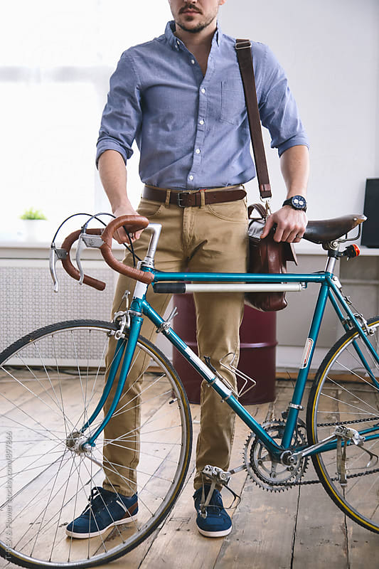 Elegant man holding his vintage bicycle by T-REX & Flower for Stocksy United