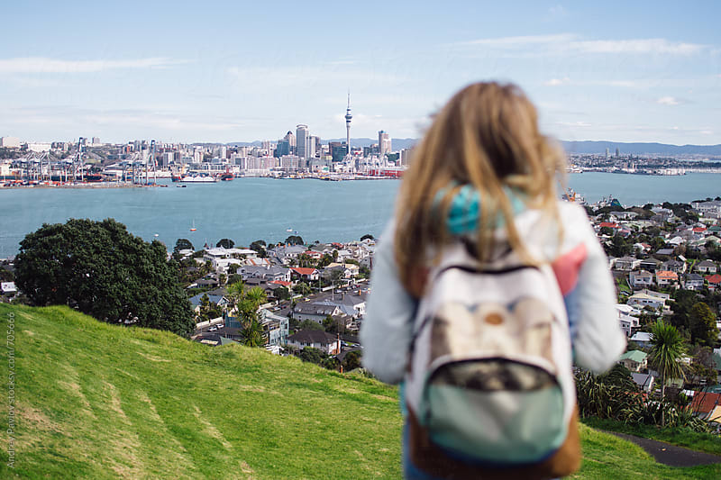 Woman looking at Auckland from viewpoint at Devonport, New Zealand by Andrey Pavlov for Stocksy United