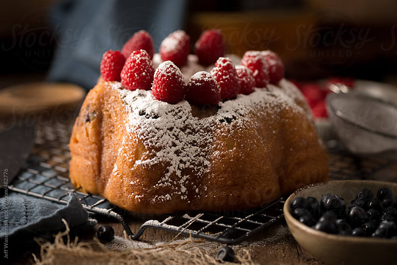 Rum Cake with Raspberries and Icing Sugar by Jeff Wasserman for Stocksy United