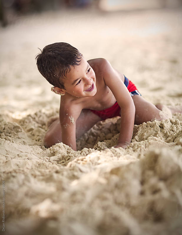 Digging In The Sand by Dejan Ristovski for Stocksy United