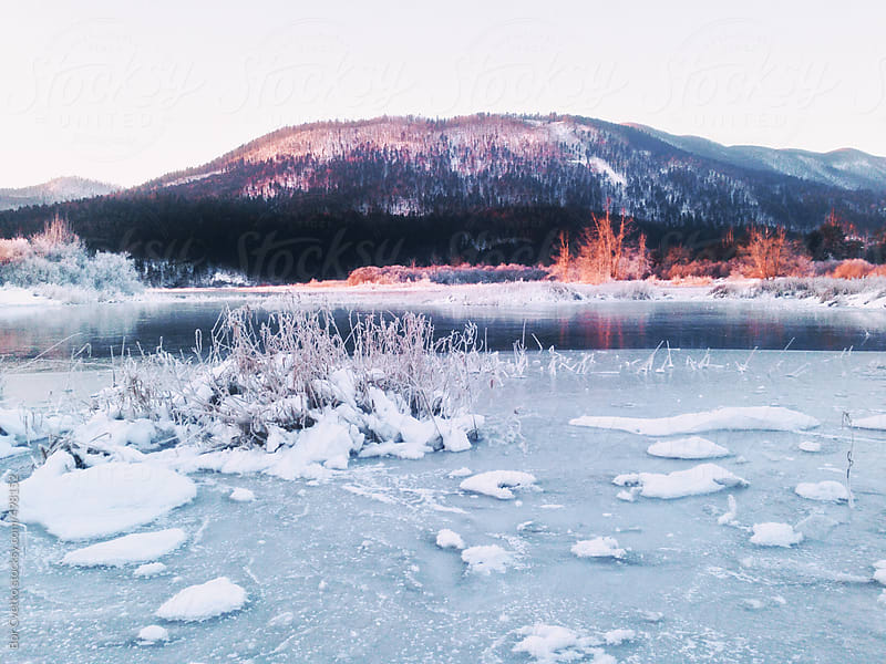 Sunrise and frozen lake by Bor Cvetko for Stocksy United