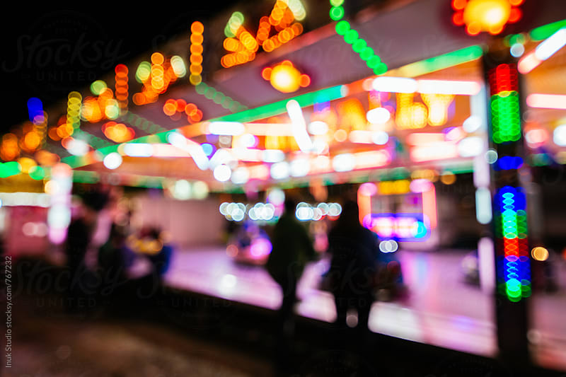 Bumper cars in a fair blurred image by Inuk Studio for Stocksy United