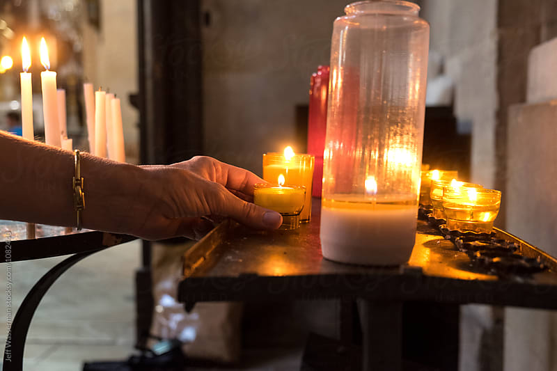 Candles in Church by Jeff Wasserman for Stocksy United