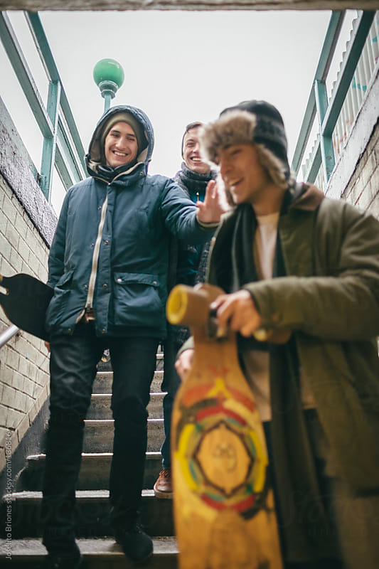 Group of Student Friends Going to Subway Station with Skateboard by Joselito Briones for Stocksy United