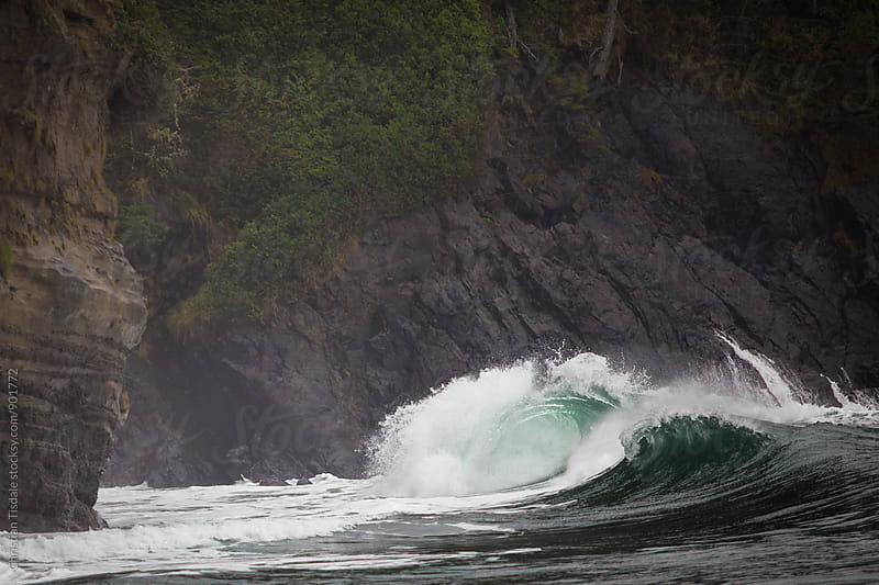 Barrelled wave hitting the rocky shore in the PNW by Christian Tisdale for Stocksy United